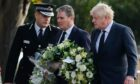 Essex chief constable Ben-Julian Harrington joins Sir Keir Starmer and Boris Johnston laying a wreath at Belfairs Methodist Church in Leigh-on-Sea yesterday