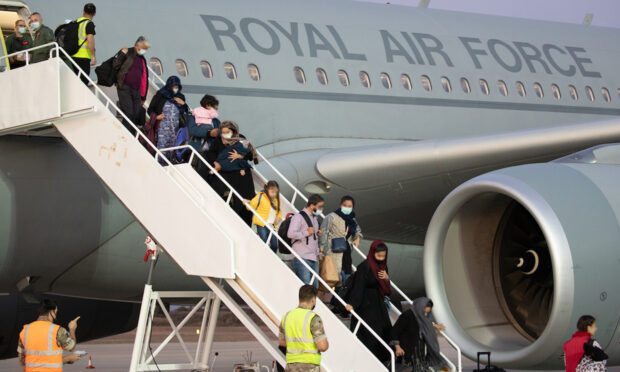 Over 100 Afghans arriving in the UK after being airlifted out of an unnamed third country by the RAF