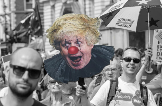 Pro-EU protesters march on Whitehall in 2018, with a caricature of Boris Johnson as a clown – how his persona is perceived by some critics