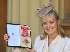 "Lesley ""Twiggy"" Lawson holds her Dame Commander of the Order of the British Empire award (John Stillwell/PA)"