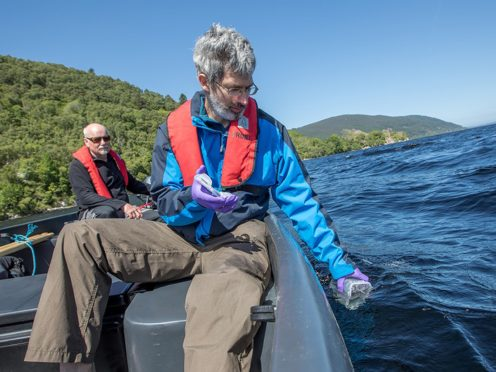 Director of the Rivers and Lochs Institute at Inverness College UHI Professor Eric Verspoor (left) and molecular ecologist Lucio Marcello in a boat on Loch Ness, are part of the team who have been investigating the waters of Loch Ness (Paul Campbell/Inverness UHI/PA)