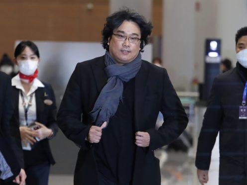 South Korean director Bong Joon-ho arrives at the Incheon International Airport in Incheon, South Korea (Ahn Young-joon/AP)