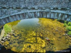 Remains of the original Ancrum bridge have been discovered under the old bridge (HES/PA)