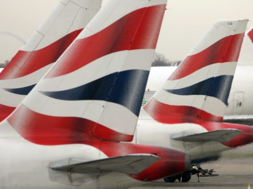 British Airways' parent company IAG has reported a £5.1bn loss in the first nine months of the year (Tim Ockenden/PA)