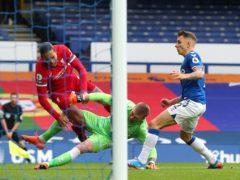 Everton keeper Jordan Pickford challenges Liverpool's Virgil Van Dijk (Peter Byrne/PA)