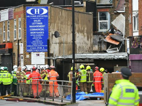 Emergency services at the scene of a suspected gas explosion on King Street in west London (Dominic Lipinski/PA)