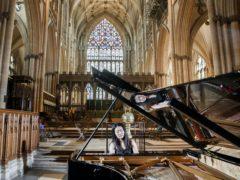 World-class concert pianist Ke Ma rehearses at York Minster (Danny Lawson/PA)