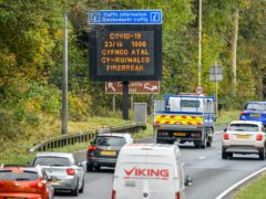 "A matrix sign on the A48(M) heading towards Cardiff informs motorists Wales will enter a two-week ""firebreak"" lockdown at 6pm on Friday (Ben Birchall/PA)"