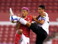 Lyle Taylor) and Derby's Curtis Davies battle for the ball (Tim Goode/PA)