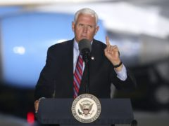 Vice-President Mike Pence speaks to supporters during a rally on Saturday (Steve Cannon/AP)