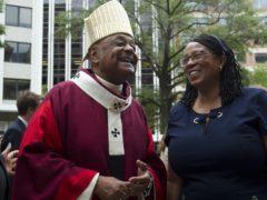 Washington DC Archbishop Wilton Gregory greets churchgoers at St Mathews Cathedral (Jose Luis Magana/AP)