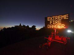 A roadside sign warns motorists of extreme fire danger on Grizzly Peak Boulevard, in Oakland (Jose Carlos Fajardo/Bay Area News Group via AP)