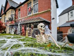 Halloween decorations at a home in Llandaff, near Cardiff ( Ben Birchall/PA)