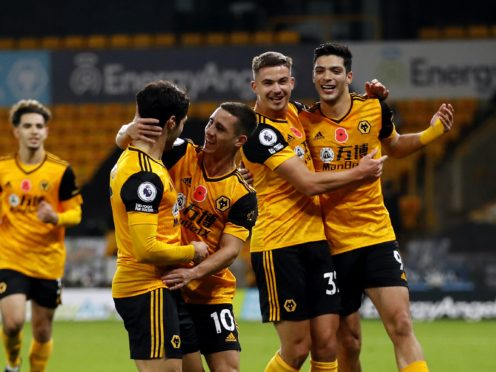 Daniel Podence celebrates his goal in Wolves' 2-0 win over Crystal Palace (Andrew Boyers/PA)