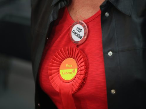A Labour Party rosette (Danny Lawson/PA)