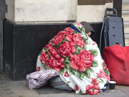 A homeless person outside Victoria Station in London (Victoria Jones/PA)