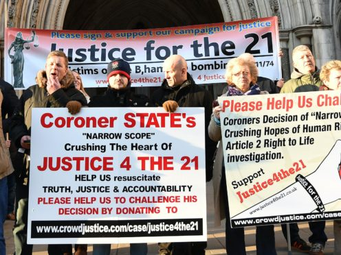 Protesters outside the High Court in London demanding justice for the 21 victims of the Birmingham pub bombings (John Stillwell/PA)