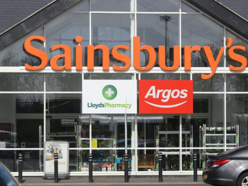 Sainsbury's is making cuts in its supermarket staffing and at Argos (Owen Humphreys/PA)