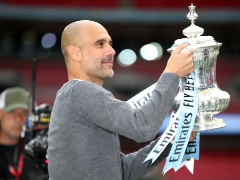 Manchester City manager Pep Guardiola celebrates with the trophy after winning the FA Cup (Nick Potts/PA)