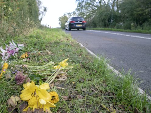 Floral tributes on the B4031 outside RAF Croughton (PA)
