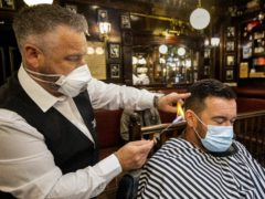 The Stormont wrangle over reopening services is a farce, Belfast barbershop owner Sean Lawlor said (Liam McBurney/PA).