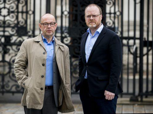 Barry McCaffrey (left) and Trevor Birney standing outside Belfast High Court (PA)