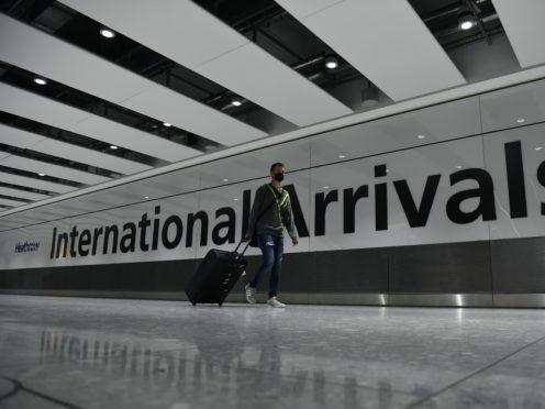 Air passenger arrivals fell 82% last month, figures show (PA)