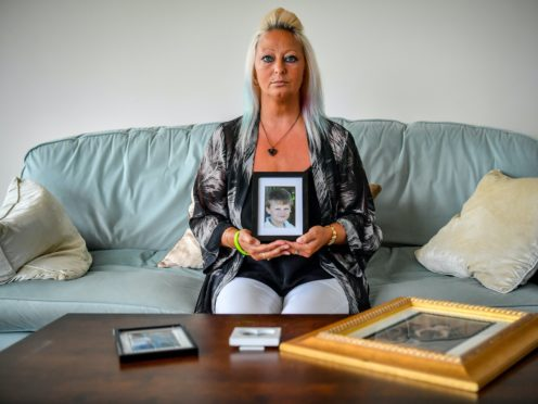 Previously unissued picture dated 17/08/20 of Charlotte Charles, mother of Harry Dunn holding a photograph of him aged 14 yrs, who has marked the anniversary of her son's death by saying his name is �forever written into history� � and vowed to carry on his family's fight for justice.