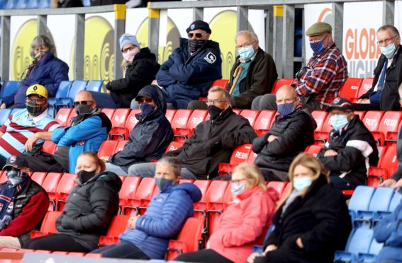 The return of fans remains a contentious issue in Scotland (Jeff Holmes/PA)