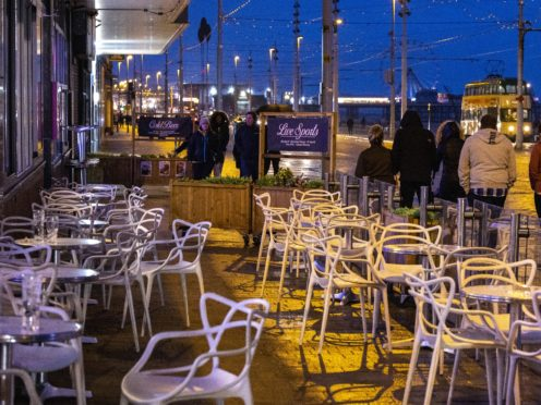 Empty chairs outside a pub in Blackpool (Peter Byrne/PA)