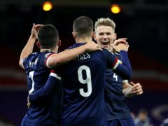 Scott McTominay (right) was overjoyed by Scotland's triumph in Belgrade (Steve Welsh/PA)