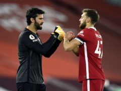 Alisson is pleased with how young defenders such as Rhys Williams and Nat Phillips, have adapted to first-team life (Peter Powell/PA)