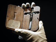 Special collections manager Dr Hannah Thomas holds Blessed Edward Oldcorne's crucifix at the Bar Convent in York (Danny Lawson/PA)