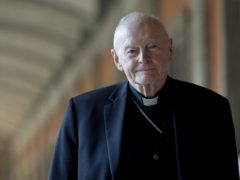 Then cardinal Theodore Edgar McCarrick poses for a photo in Rome (Andrew Medichini/AP)