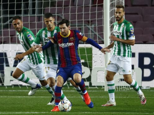 Lionel Messi changed the game with two second-half goals (Joan Monfort/AP)