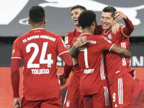 Robert Lewandowski, right, was on the score-sheet as Bayern Munich edged out Borussia Dortmund (Bernd Thissen/AP/PA)