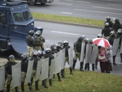 Police block a street during an opposition rally to protest the official presidential election results in Minsk, Belarus, Sunday, Nov. 8, 2020. Club-swinging police went after demonstrators in the Belarusian capital who were demanding the resignation of the country's authoritarian president on Sunday, the 90th consecutive day of protests in the country. Human rights activists said nearly 400 people were arrested. (AP Photo)