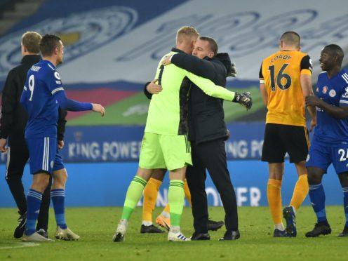 Leicester manager Brendan Rodgers congratulates goalkeeper Kasper Schmeichel (Rui Vieira/PA)