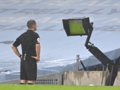 Referee Craig Pawson was one of a number of referees to consult his pitchside monitor over VAR calls (Shaun Botterill/PA)