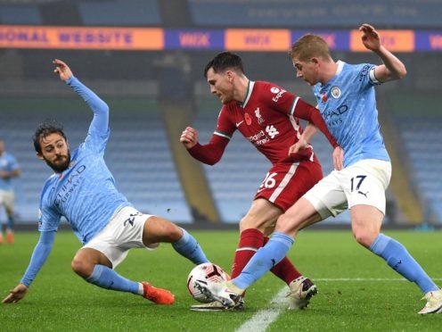 Andrew Robertson (centre) battles for the ball against Manchester City (Shaun Botterill/PA)