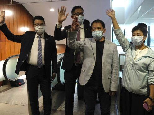 Pro-democracy politicians, from right, Wong Pik Wan, Wu Chi Wai, Lam Cheuk-ting, Yoon Siu Kin wave after handing in their letters at Legislative Council in Hong Kong (Vicent Yu/AP)