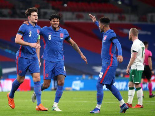 Harry Maguire (left) celebrates scoring the opening goal against the Republic of Ireland (Nick Potts/PA).
