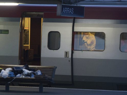 A police officer videos the crime scene inside a Thalys train at Arras train station, northern France, in 2015 (AP)