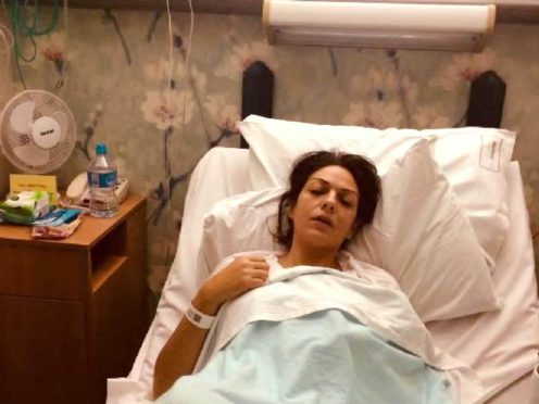 Photo used on a GoFundMe page showing Nicole Elkabbas on a hospital bed which the prosecution say was 'staged to convince people that she was seriously unwell' (CPS)