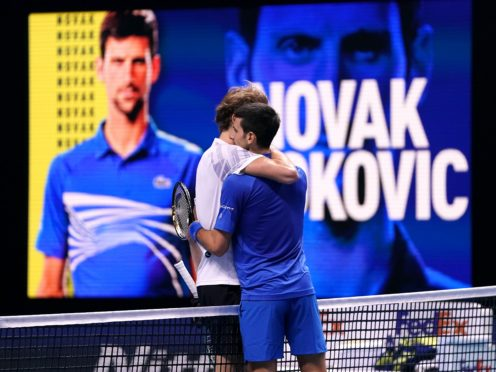 Novak Djokovic (right) embraces Alexander Zverev after their match at The O2 (John Walton/PA)
