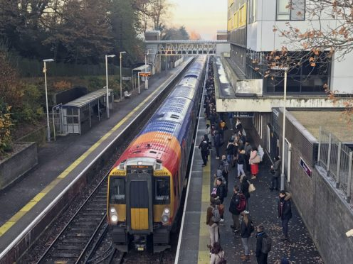 Labour is calling on the Government to suspend peak fares to help avoid overcrowding on trains during the festive season (Steve Parsons/PA)
