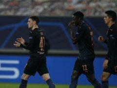 Phil Foden, left, celebrates his goal (Thanassis Stavrakis/AP)