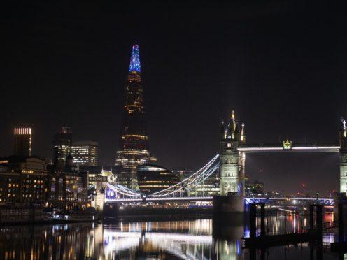 The Shard is illuminated for a new Christmas light display (Dominic Lipinski/PA)