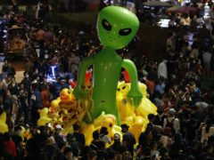 Protesters gather balloons shaped like aliens – to mock accusations that foreigners fund and direct their movement (Sakchai Lalit/AP)