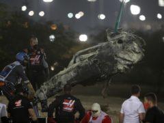 The force of the impact split Romain Grosjean's machine in two (Tolga Bozoglu/PA)